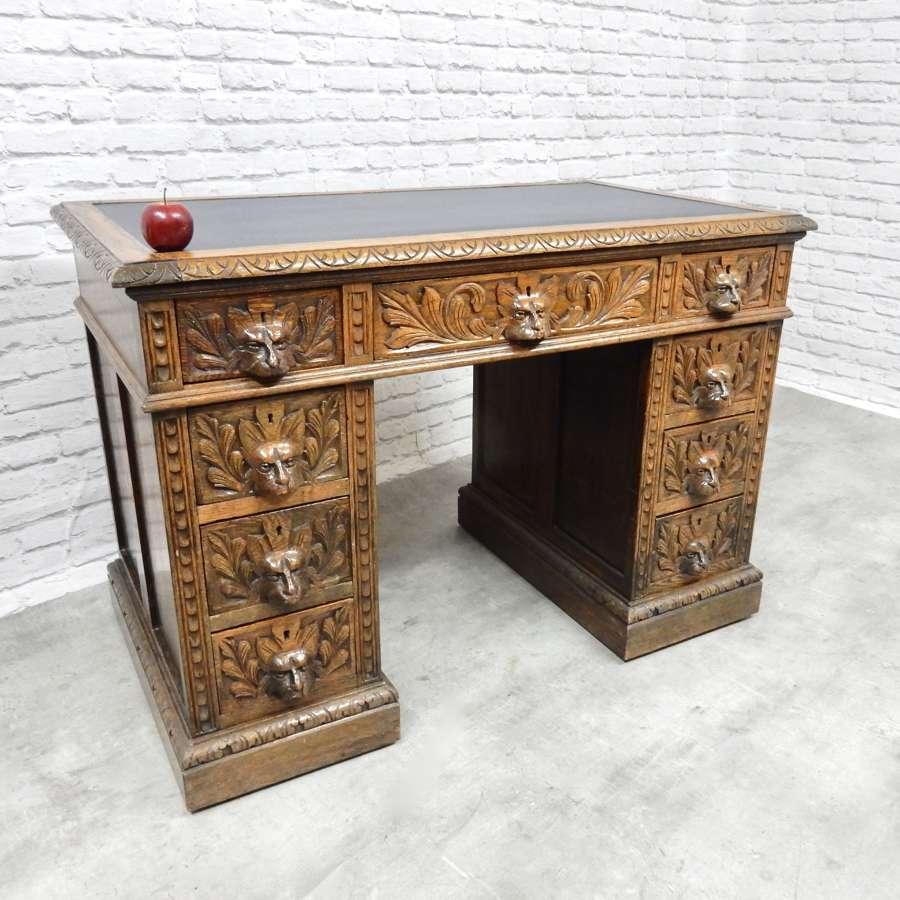 Antique Green Man Oak Desk